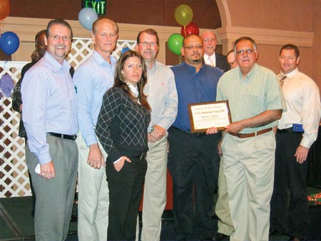 Recognizing the safety record at South Florida Materials Corp. are, from the left, Todd Cannon, Vecenergy COO; Glen Moll, Safety Manager; Jamie Peck, Environmental Health & Safety Coordinator; Tad Todd, Director Safety, Security & Special Projects; Gerardo Almodovar; Safety Council board member Harry Lux; Andrew Hatcher (back); Eddie Palenzuela, Facility Manager; and Vecellio Group V.P. of Safety Mark Ligon.