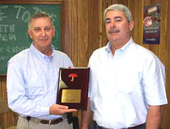 "Mike Slade, left, President of Ranger's Central Division, receives a plaque from Tim McGrath of Travelers recognizing the division's ""no lost time"" achievements."