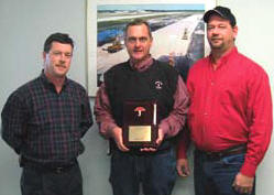 "Steve Beals from Travelers, left, presents Sharpe Bros. V.P. Ivan Clayton, center, and Safety Director John Riley, Jr., with a plaque recognizing Sharpe Bros.' two years without a ""lost time"" incident."
