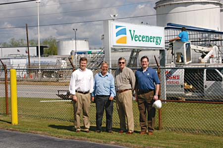 Christopher Vecellio, Terminal Operator Kevin Coleman, Leo Vecellio and Michael Vecellio tour a Vecenergy petroleum products terminal in Macon, GA, one of two terminals recently acquired from Chevron. (Photo by Craig Smith)